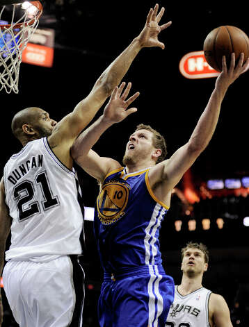 Golden State Warriors' David Lee (10) shoots over San Antonio Spurs' Tim Duncan during the second half of an NBA basketball game, Wednesday, March 20, 2013, in San Antonio. San Antonio won 104-93. Photo: Darren Abate, Associated Press / FR115 AP