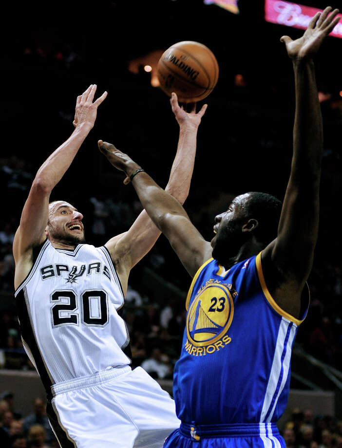 San Antonio Spurs' Manu Ginobili (20), of Argentina, shoots over Golden State Warriors' Draymond Green during the first half of an NBA basketball game, Wednesday, March 20, 2013, in San Antonio. San Antonio won 104-93. Photo: Darren Abate, Associated Press / FR115 AP