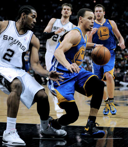 Golden State Warriors' Stephen Curry, right, is tripped by San Antonio Spurs' Kawhi Leonard during the second half of an NBA basketball game, Wednesday, March 20, 2013, in San Antonio. San Antonio won 104-93. Photo: Darren Abate, Associated Press / FR115 AP