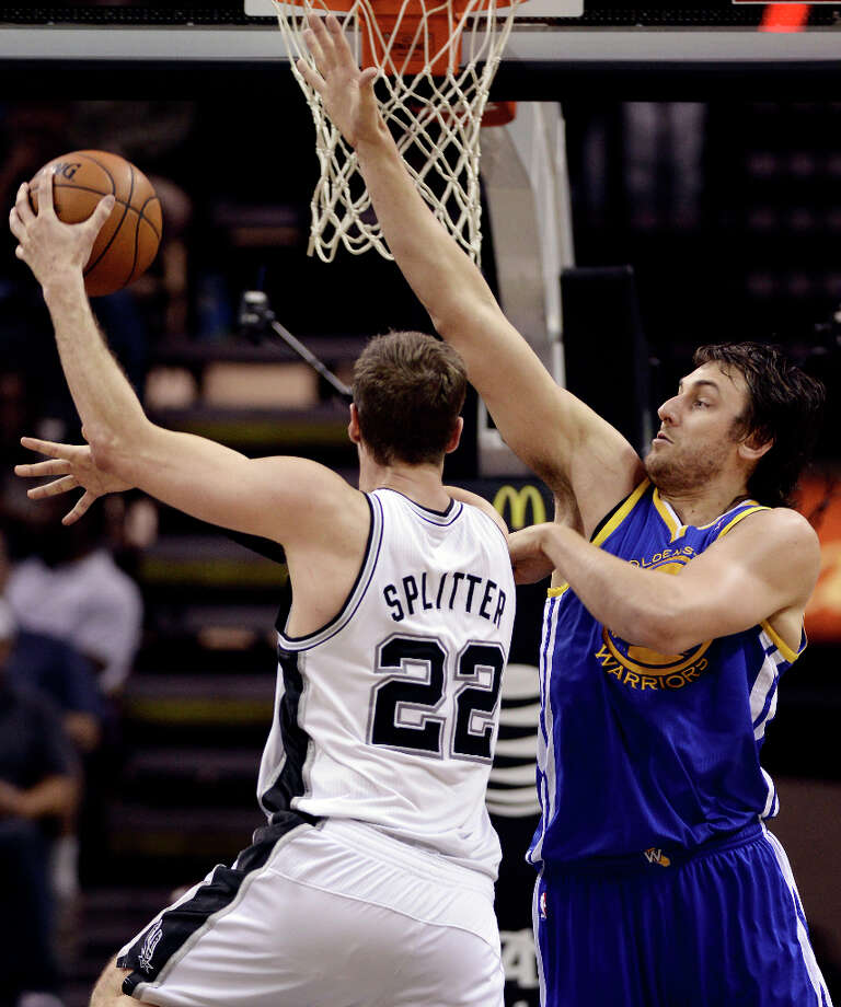 Golden State Warriors' Andrew Bogut, right, defends against San Antonio Spurs' Tiago Splitter, of Brazil, during the second half of an NBA basketball game, Wednesday, March 20, 2013, in San Antonio. San Antonio won 104-93. Photo: Darren Abate, Associated Press / FR115 AP