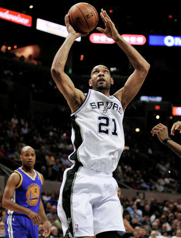 San Antonio Spurs' Tim Duncan shoots during the first half of an NBA basketball game against the Golden State Warriors, Wednesday, March 20, 2013, in San Antonio. San Antonio won 104-93. Photo: Darren Abate, Associated Press / FR115 AP