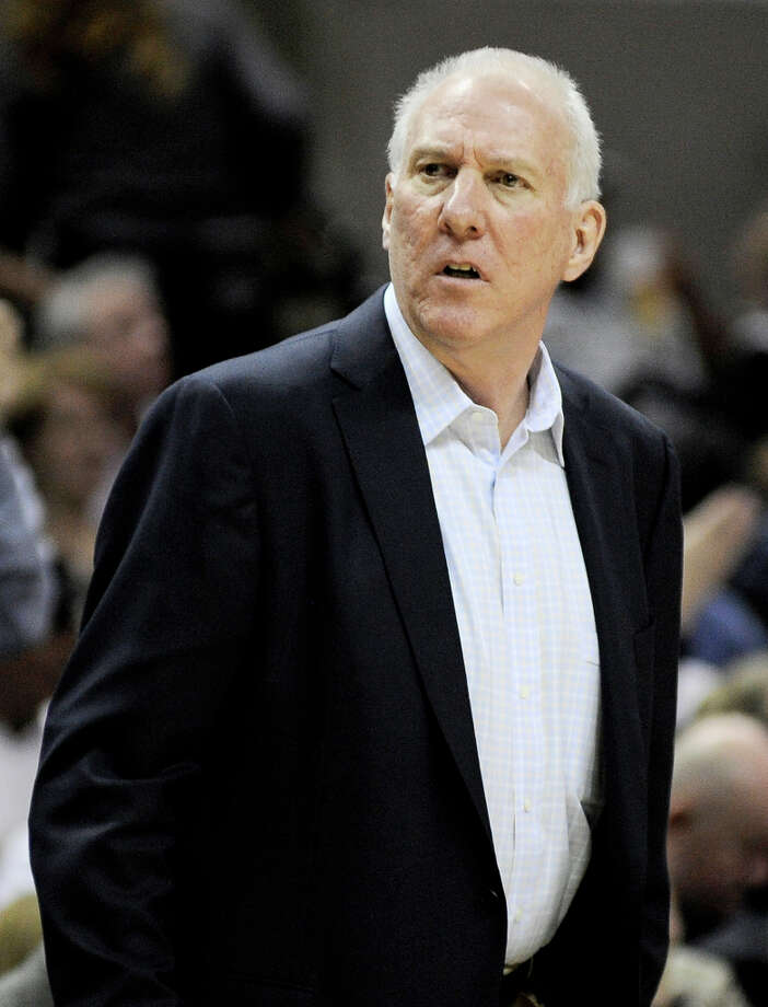 San Antonio Spurs head coach Gregg Popovich watches play during the second half of an NBA basketball game against the Golden State Warriors, Wednesday, March 20, 2013, in San Antonio. San Antonio won 104-93. Photo: Darren Abate, Associated Press / FR115 AP