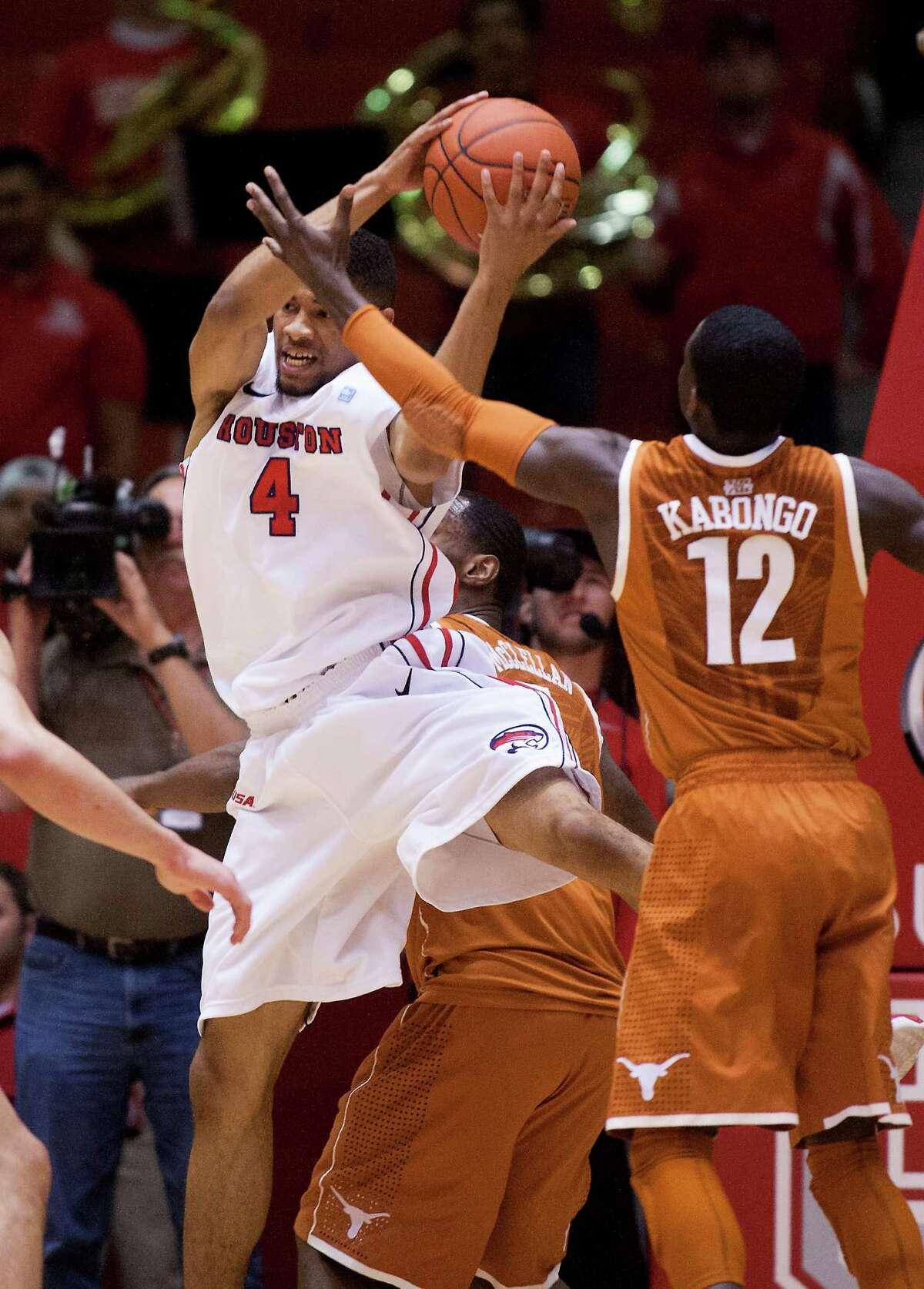 U of H guard LeRon Barnes (4) brings down a rebound against Texas guard Myck Kabongo (12) during the first half of the CBI men's postseason basketball tournament at Hofheinz Pavillion on Wednesday, March 20, 2013, in Houston.