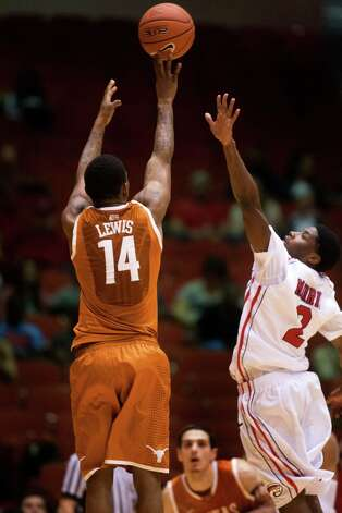 Texas guard Julien Lewis (14) takes a shot over U of H guard Brandon Morris (2) during the second half of the CBI men's postseason basketball tournament at Hofheinz Pavillion on Wednesday, March 20, 2013, in Houston. Photo: J. Patric Schneider, For The Chronicle / © 2013 Houston Chronicle