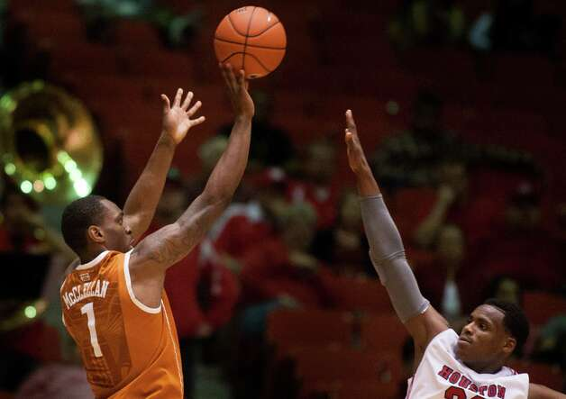 Texas guard Sheldon McClellan (1) takes a shot over U of H forward Danuel House (23) during the second half of the CBI men's postseason basketball tournament at Hofheinz Pavillion on Wednesday, March 20, 2013, in Houston. Photo: J. Patric Schneider, For The Chronicle / © 2013 Houston Chronicle