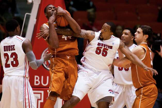 U of H forward J.J. Richardson (55) and Texas center Prince Ibeh (44) battle for a rebound during the second half of the CBI men's postseason basketball tournament at Hofheinz Pavillion on Wednesday, March 20, 2013, in Houston. Photo: J. Patric Schneider, For The Chronicle / © 2013 Houston Chronicle