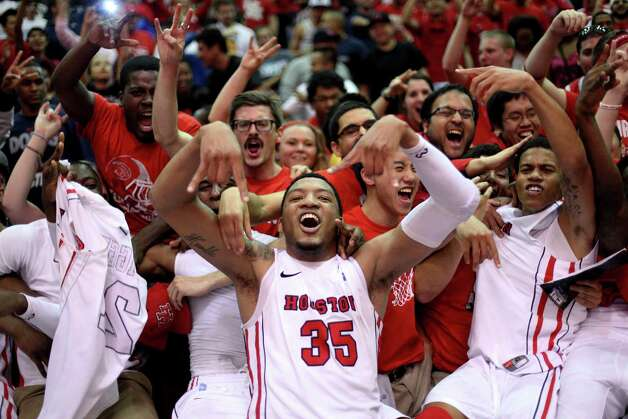 Houston's TaShawn Thomas celebrates after Houston's 73-72 victory over Texas in a CBI college basketball tournament game in Houston on Wednesday, March 20, 2013. (AP Photo/The Daily Texan, Lawrence Peart) Photo: Lawrence Peart, Associated Press / The Daily Texan
