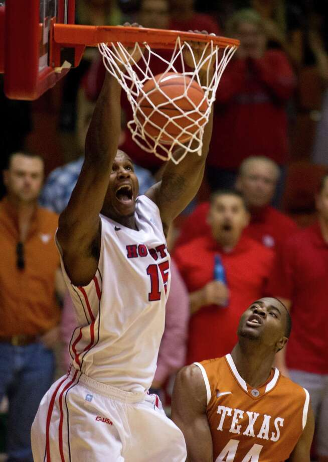 U of H forward Leon Gibson (15) dunks over Texas center Prince Ibeh (44) during the second half of the CBI men's postseason basketball tournament at Hofheinz Pavillion on Wednesday, March 20, 2013, in Houston. The cougars defeated Texas 73-72. Photo: J. Patric Schneider, For The Chronicle / © 2013 Houston Chronicle