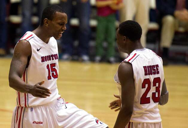 U of H Leon Gibson (15) and Danuel House (23) celebrate after Gibson made a basket during the second half of the CBI men's postseason basketball tournament against the University of Texas at Hofheinz Pavillion on Wednesday, March 20, 2013, in Houston. Photo: J. Patric Schneider, For The Chronicle / © 2013 Houston Chronicle