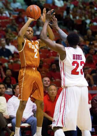 Texas' Demarcus Holland (2) shoots against Houston's Danuel House (23) during the first half of their College Basketball Invitational tournament game, Wednesday, March 20, 2013, in Houston. (AP Photo/Houston Chronicle, J. Patric Schneider)  MANDATORY CREDIT Photo: J. Patric Schneider, Associated Press / Houston Chronicle