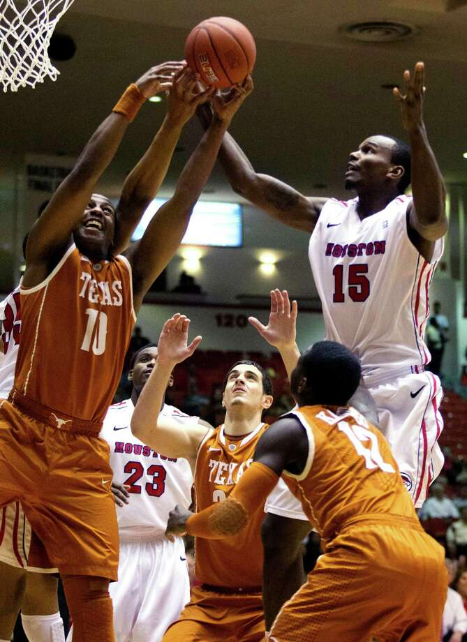 Houston forward Leon Gibson (15) and Texas forward Jonathan Holmes (10) battle for a rebound during the first half of their College Basketball Invitational tournament game, Wednesday, March 20, 2013, in Houston. (AP Photo/Houston Chronicle, J. Patric Schneider)  MANDATORY CREDIT Photo: J. Patric Schneider, Associated Press / Houston Chronicle