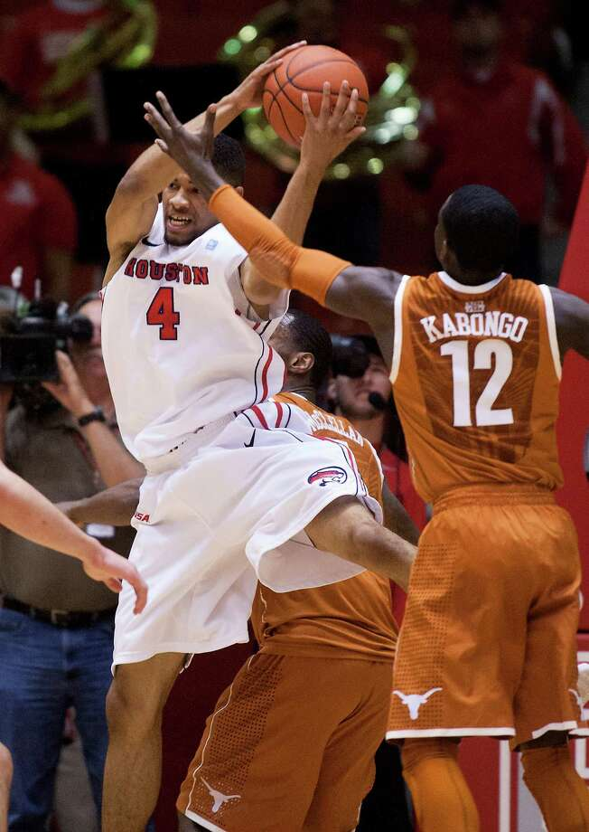 Houston guard LeRon Barnes (4) brings down a rebound against Texas guard Myck Kabongo (12) during the first half of a CBI college basketball tournament game Wednesday, March 20, 2013, in Houston. (AP Photo/Houston Chronicle, J. Patric Schneider) MANDATORY CREDIT Photo: J. Patric Schneider, Associated Press / Houston Chronicle