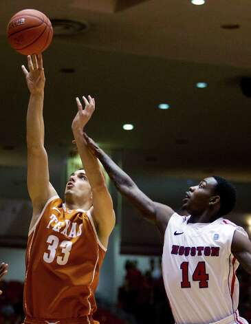 Texas forward Ioannis Papetrou (33) shoots against Houston guard Tione Womack (14) during the first half of their College Basketball Invitational tournament game, Wednesday, March 20, 2013, in Houston. (AP Photo/Houston Chronicle, J. Patric Schneider)  MANDATORY CREDIT Photo: J. Patric Schneider, Associated Press / Houston Chronicle
