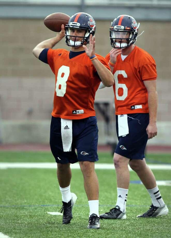 UTSA quarterbacks Eric Soza, left, and Tucker Carter, during a practice on Wednesday, March 20, 2013 at Farris Stadium. Photo: Bob Owen, San Antonio Express-News / San Antonio Express-News