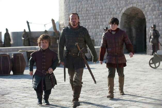 "Peter Dinklage as ""Tyrion Lannister,"" Jerome Flynn as ""Bronn"" and Daniel Portman as ""Podrick Payne"" in the first episode of season 3. Photo: Keith Bernstein / Keith Bernstein"