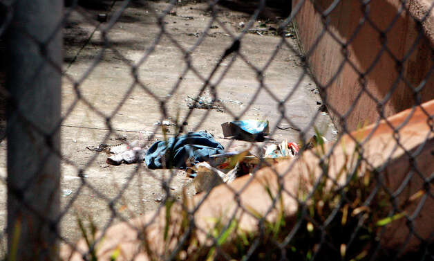 Trash surrounds the closed off former UC Extension site Haight and Laguna on March 17th, 2013 in San Francisco, Calif. It has been abandoned for some time now. While neighborhood associations have tried their hardest to make it look pleasing with there are bright, vibrant murals on one side, much of it looks like it's just an old building. The grass is overgrown with constant broken glass around it. The city's planning department approved a plan to turn it into housing, with construction slated to begin in summer 2013. Photo: Jessica Olthof, The Chronicle / ONLINE_YES