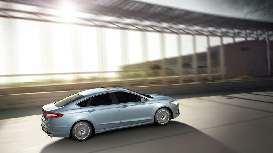 2013 Ford Fusion Hybrid: The all-new Ford Fusion Hybrid sedan is expected to deliver at least 47 mpg highway and travel up to 62 mph on full electric power. (09/17/2012) Photo: Ford, Ford Motor Co. / Copyright 2012