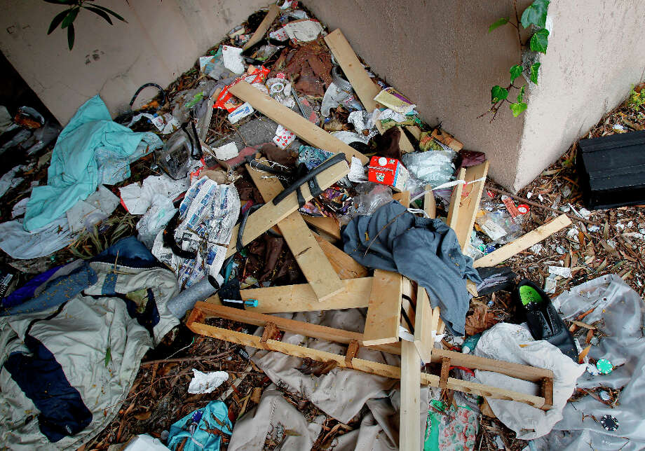 Debris from a homeless encampment just off Haight Street on school property. The former UC Extension site at Haight and Laguna Streets in San Francisco, Calif. is full of litter, graffiti and a hangout for the homeless Wednesday March 20, 2013. Photo: Brant Ward, The Chronicle / ONLINE_YES