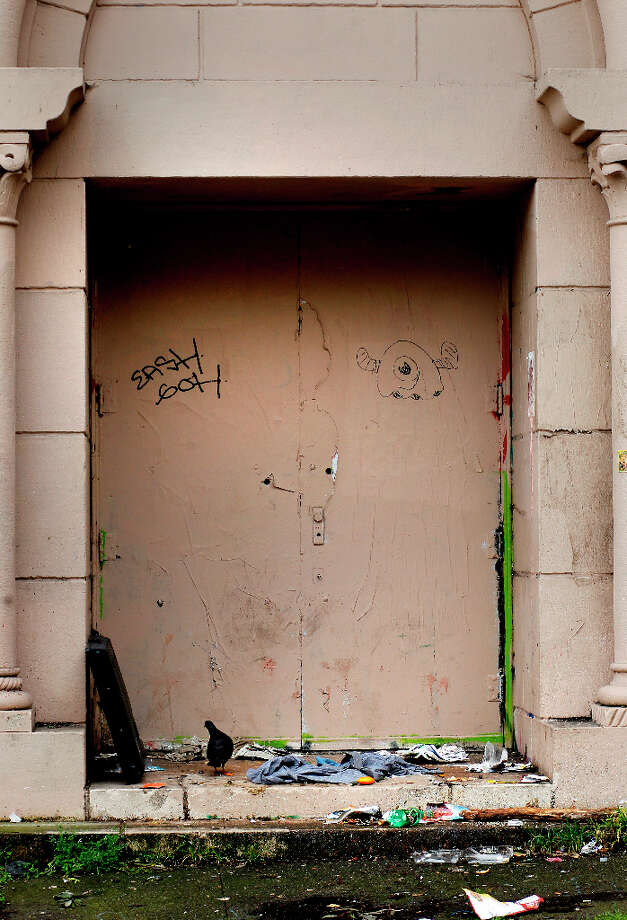 An old entryway into the school on Haight Street shows evidence of people sleeping in the doorway and litter that a pigeon cannot ignore. The former UC Extension site at Haight and Laguna Streets in San Francisco, Calif. is full of litter, graffiti and a hangout for the homeless Wednesday March 20, 2013. Photo: Brant Ward, The Chronicle / ONLINE_YES