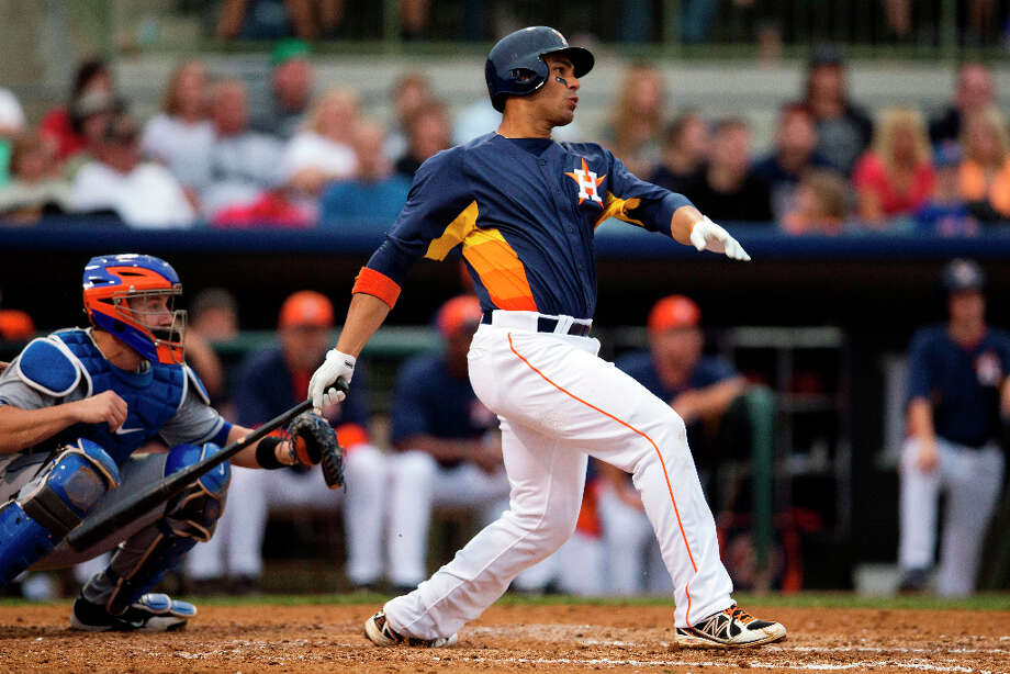 Astros 7, Mets 5Mets catcher John Buck, left, watches as Carlos Pena hits an RBI single. Photo: Evan Vucci, Associated Press / AP