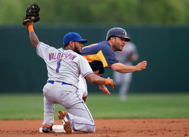 Mets infielder Jordany Valdespin, left, and Jose Altuve look to the second base umpire after Altuve stole second. Photo: Evan Vucci, Associated Press / AP