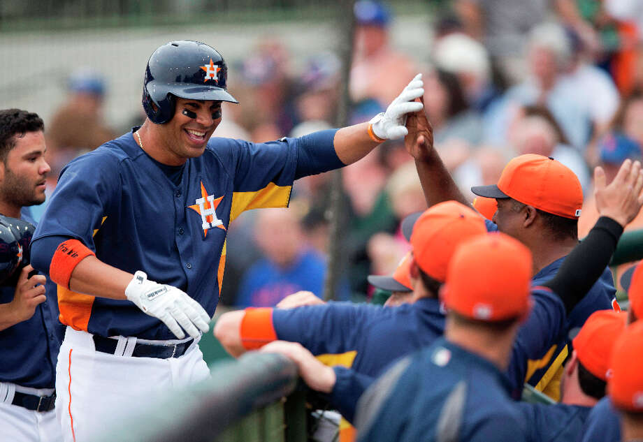 Carlos Pena smiles as he walks back to the dugout after hitting a two-run home run. Photo: Evan Vucci, Associated Press / AP