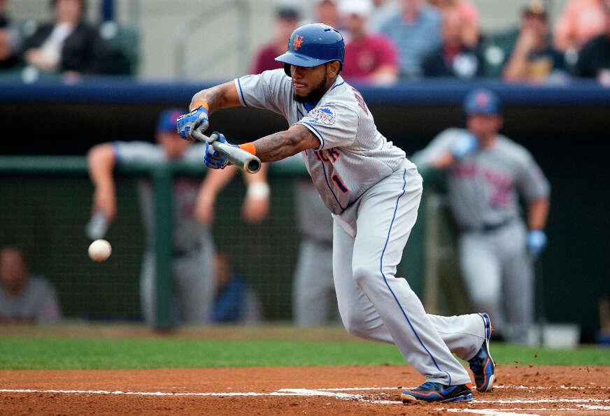 Jordany Valdespin bunts for a base hit.