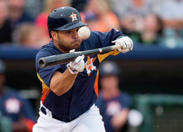 Jose Altuve attempts to bunt for a hit during the second inning. Photo: Evan Vucci, Associated Press / AP
