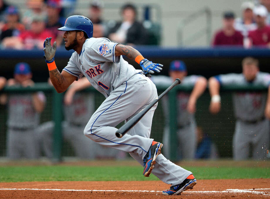 Jordany Valdespin sprints to first after bunting for a hit. Photo: Evan Vucci, Associated Press / AP
