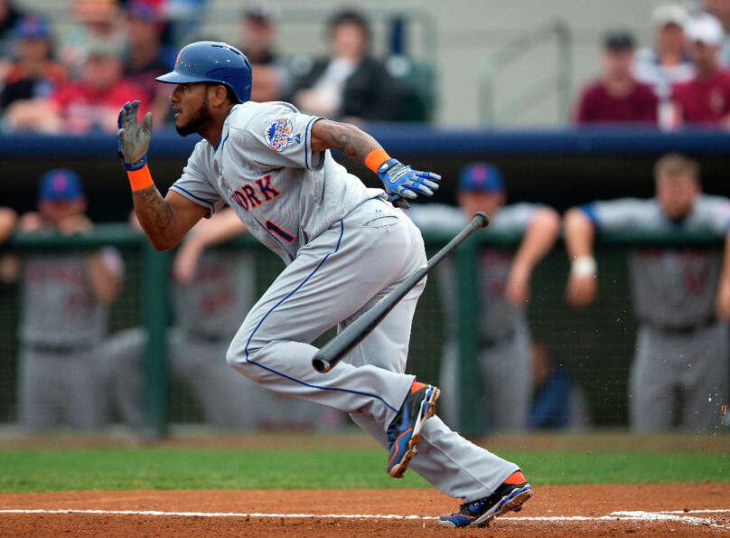 Jordany Valdespin sprints to first after bunting for a hit.