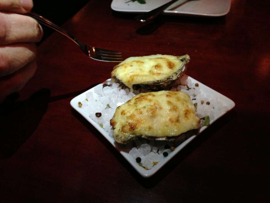 Oysters ($3 each) were heavily blanketed in cheese