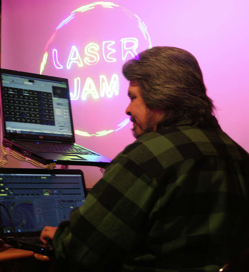 "Rich Evans, producer of ""The Ultimate Laser Light Show Experience"" at Bridgeport's Discovery Museum, works in his Seymour studio. The rock music- light shows will run Friday and Saturday evenings through May 26. Photo: Contributed Photo"
