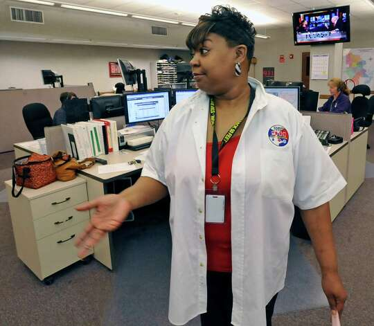At the 911 Operations Center at the corner of Orleans and Forsythe, Carolyn Lewis, a 20 year veteran, is the Training/QA Supervisior/Dispatch Operator.  Here she, is talking to about how the telecommunicators take the calls that come in.  Dave Ryan/The Enterprise Photo: Dave Ryan