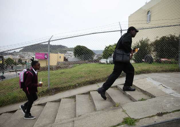 Thomas Bailey (right) and his daughter Ashanti Bailey (left), walk up a hill as they head over to Raphael House for an intake appointment for their new room on Monday, March 18, 2013 in San Francisco, Calif. Photo: Lea Suzuki, The Chronicle / ONLINE_YES