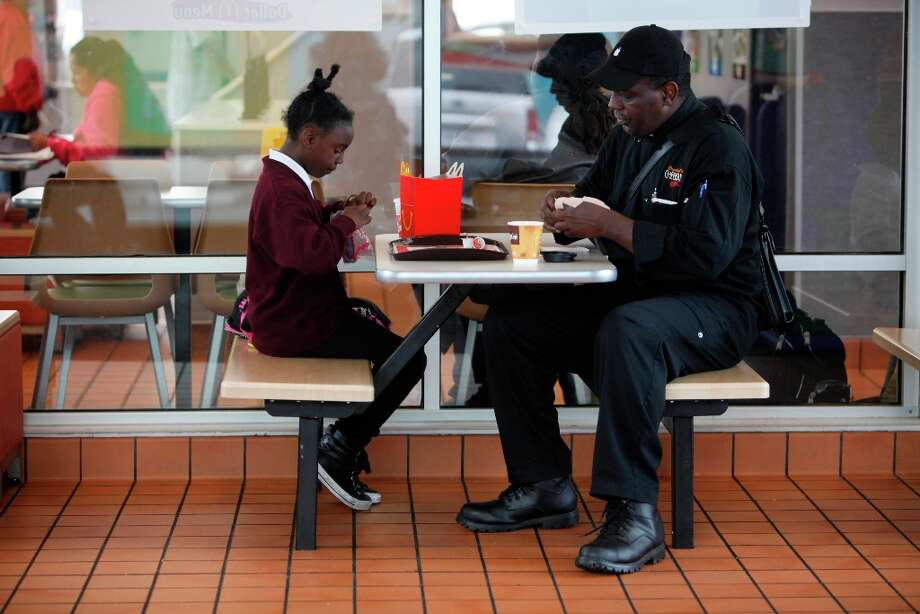 Thomas Bailey (right) and his daughter Ashanti Bailey (left), 10 enjoy a snack before going to Raphael House for an intake appointment for their new room on Monday, March 18, 2013 in San Francisco, Calif. Photo: Lea Suzuki, The Chronicle / ONLINE_YES