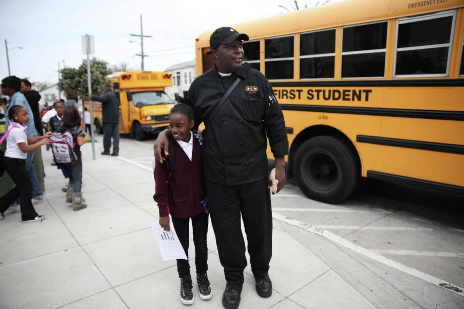 Thomas Bailey  (right)  wraps his arm around his daughter Ashanti Bailey, (left)10, after picking her up after school from Charles R. Drew elementary school on Monday, March 18, 2013 in San Francisco, Calif. Photo: Lea Suzuki, The Chronicle / ONLINE_YES