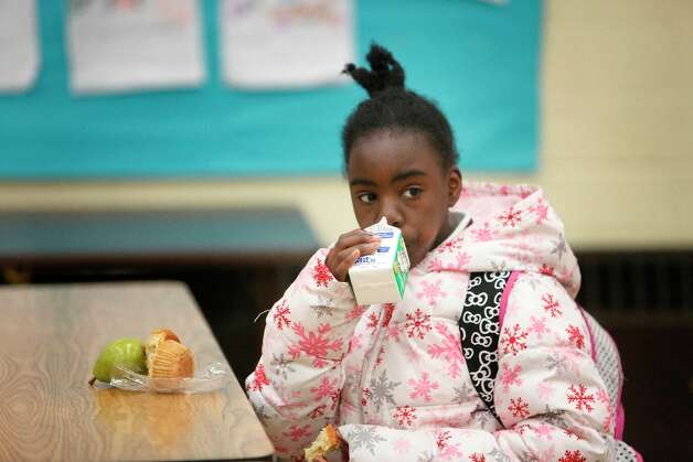 Ashanti Bailey 10, drinks a carton of milk during breakfast at Charles R. Drew elementary school on Wednesday, March 20, 2013 in San Francisco, Calif. Photo: Lea Suzuki, The Chronicle / ONLINE_YES