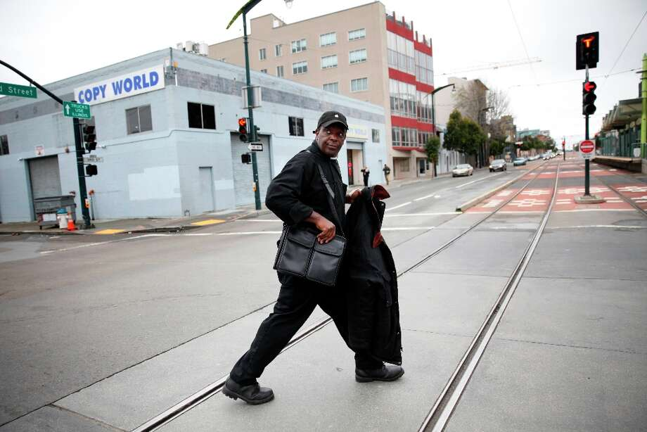 Thomas Bailey jogs across Third Street on his way to the Mission Workforce Development Center to look for job leads after collecting a warm jacket from storage on Wednesday, March 20, 2013 in San Francisco, Calif. Photo: Lea Suzuki, The Chronicle / ONLINE_YES