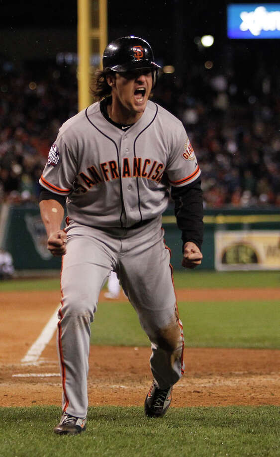 Giants' DH Ryan Theriot reacts as he crosses the plate in the 10th inning on a Marco Scutaro single during game 4 of the World Series at Comerica Park on Sunday, Oct. 28, 2012 in Detroit, MI. Photo: Michael Macor, The Chronicle / ONLINE_YES