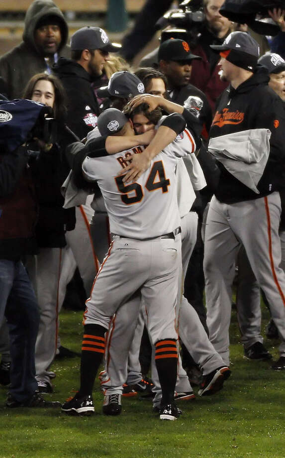 Ryan Theriot, rear, gives Sergio Romo a hug after the San Francisco Giants defeated the Detroit Tigers in Game 4 of the World Series on Sunday, October 27, 2012, in Detroit, Mi. The Giants are the 2012 World Champions after sweeping the Tigers. Photo: Carlos Avila Gonzalez, The Chronicle / ONLINE_YES