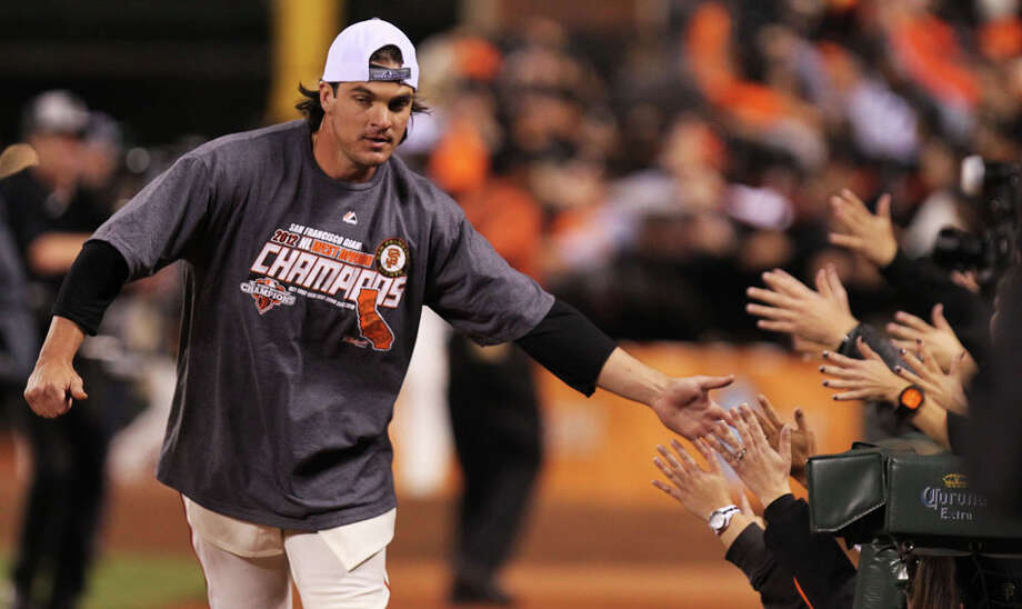 Ryan Theriot shakes hands with the fans as the San Francisco Giants celebrate their 8-4 win over the San Diego Padres that gave them the National League West title Saturday September 22, 2012. In San Francisco California. Photo: Lance Iversen, The Chronicle / ONLINE_YES