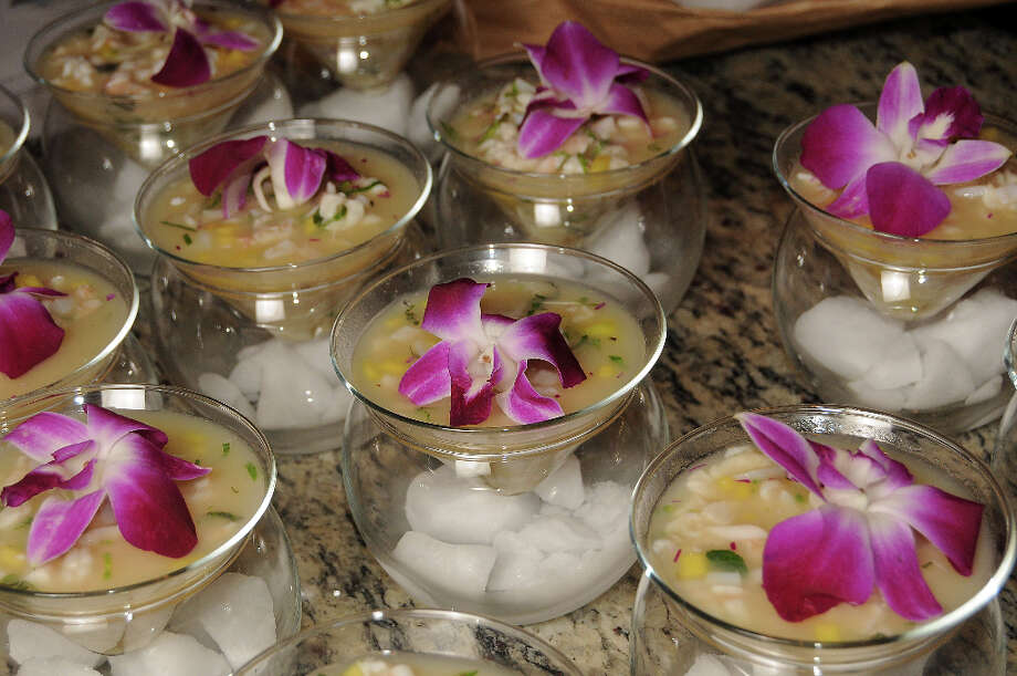 Each ceviche was topped with an edible orchid that had a sliver of mint tucked deep inside. Photo: Dave Rossman, For The Houston Chronicle / © 2013 Dave Rossman