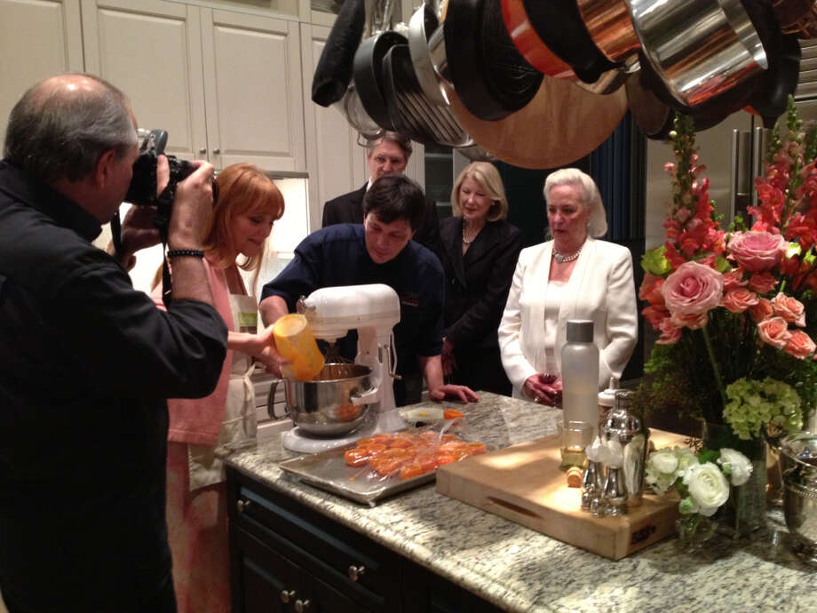 Chef Olivier enlisted help from Gracie Cavnar to prepare the sorbet. Bob Cavnar caught the action, as Gayle Bentsen and Janie Patterson watched.