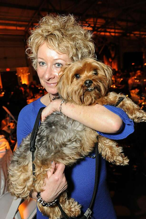 Cindy Perry gives Lucky a hug at the San Francisco SPCA's Bark & Whine Ball 2013. Photo: Drew Altizer Photography