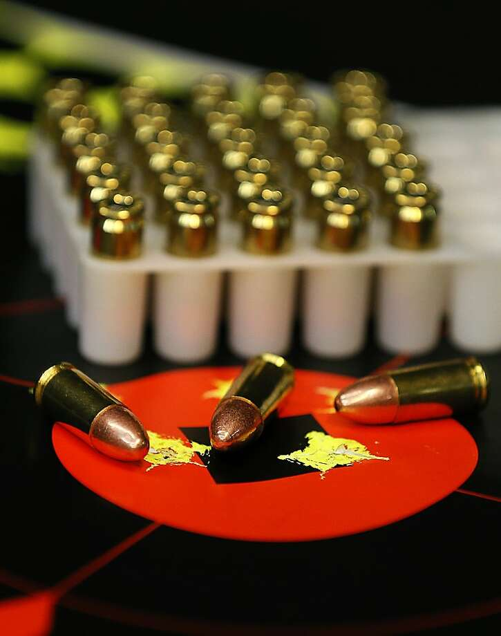 9mm bullets are arranged for a photograph at the Rangemasters of Utah gun range in Springville, Utah, U.S., on Thursday, Feb. 28, 2013. President Barack Obama has called for a ban on assault-style weapons in addition to expanded background checks and limits on ammunition magazines, in response to the killing of 20 children and six adults at a Newtown, Connecticut school in December. Photographer: George Frey/Bloomberg Photo: George Frey, Bloomberg