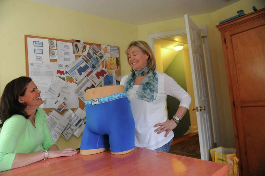 Susan Jaffe, left, and Susan White, co-owners of Turq LLC, have invented a product for men to wear under their swimtrunks, in White's home office, in Riverside, Conn., Thursday, March 21, 2013. Photo: Helen Neafsey / Greenwich Time