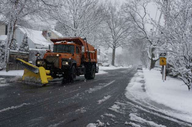 A Fairfield municipal plow makes its rounds during the March 8 storm Photo: Genevieve Reilly / Fairfield Citizen