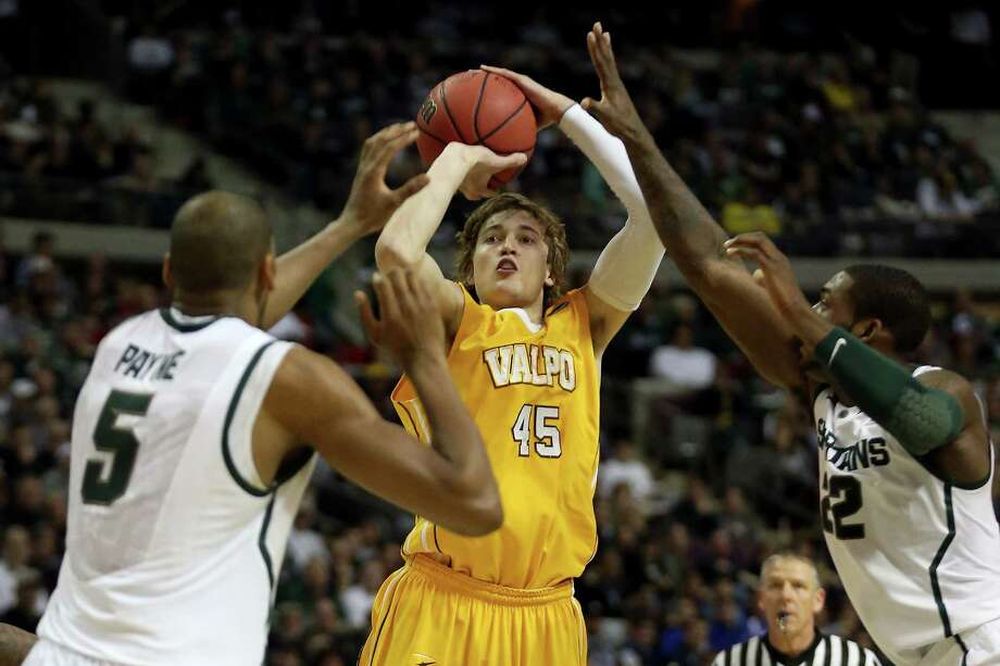 AUBURN HILLS, MI - MARCH 21:  Ryan Broekhoff #45 of the Valparaiso Crusaders is fouled by Branden Dawson #22 of the Michigan State Spartans as he attempts a shot against Adreian Payne #5 of the Michigan State in the first half during the second round of the 2013 NCAA Men's Basketball Tournament at at The Palace of Auburn Hills on March 21, 2013 in Auburn Hills, Michigan. Photo: Jonathan Daniel, Getty Images / 2013 Getty Images