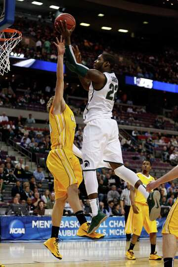 AUBURN HILLS, MI - MARCH 21:  Branden Dawson #22 of the Michigan State Spartans drives for a shot at