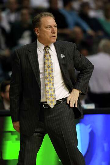 AUBURN HILLS, MI - MARCH 21:  Head coach Tom Izzo of the Michigan State Spartans coaches in the firs